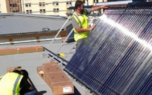 solar hot water heating image of evacuated tubes installation in Wellington