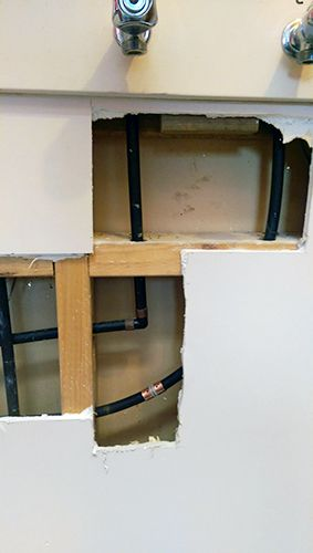Dux qest polybutylene burst pipe in laundry wall resulted in a call out easter 2015