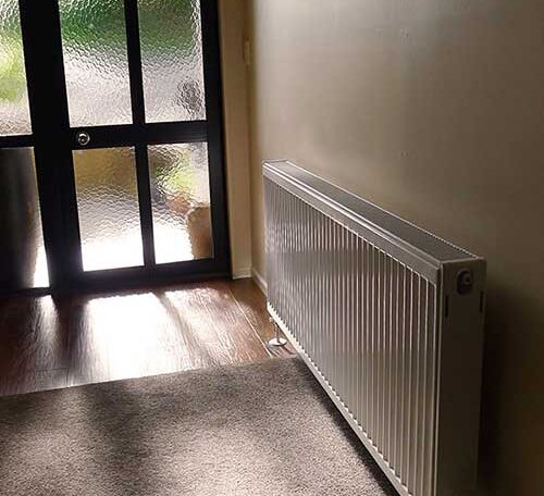 Image of central heating radiator wellington in a hallway. Wellington radiator central heating. Very efficient heating using radiators